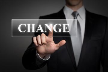 businessman pressing touchscreen button - change