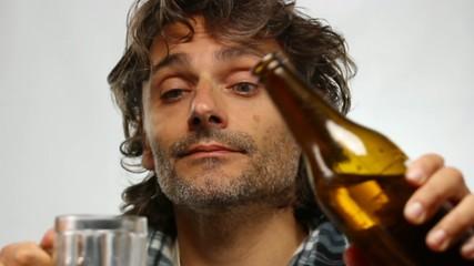 funny unshaven man drinking beer