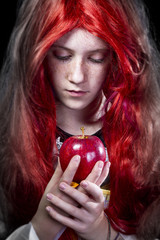 Girl with red apple in a poetic representation