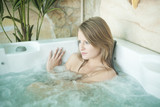Sexy beautiful blonde woman in the jacuzzi