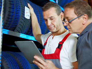 Master mechanics looking for the right tire  with touchpad