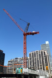 high-rise building crane on top of building