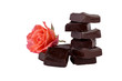 chocolate pieces tower with flower isolated on white