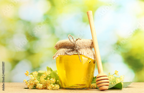 jar with linden honey and flowers