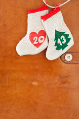 2013 New Year date concept wishes bags on leather background
