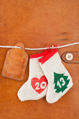 New Year 2013 date concept wishes bags, gift tag on leather