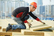 roofer worker installing roof insulation material