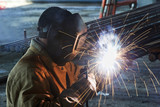 worker welding with electric arc electrode poster