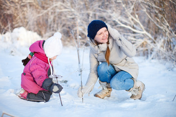 Mother and daughter outdoors at winter