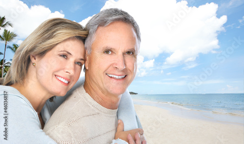Senior couple on the beach.