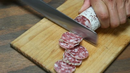 Pork sausage slices on wooden chopping board