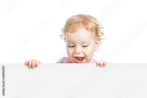 kid looking down behind white emty banner isolated