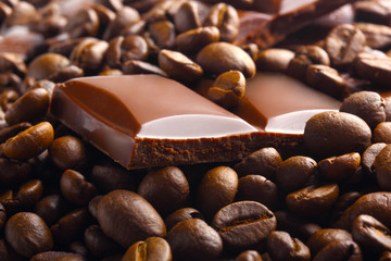 dark chocolate bar in coffee beans