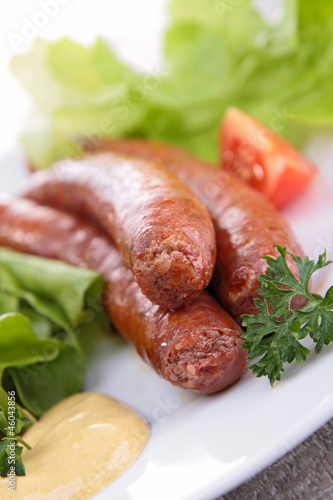 grilled sausage and salad