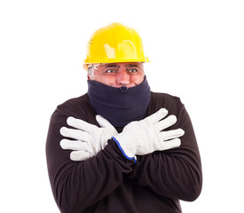 Worker suffering cold with arms crossed