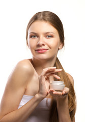 cosmetic preparation in hands of girl