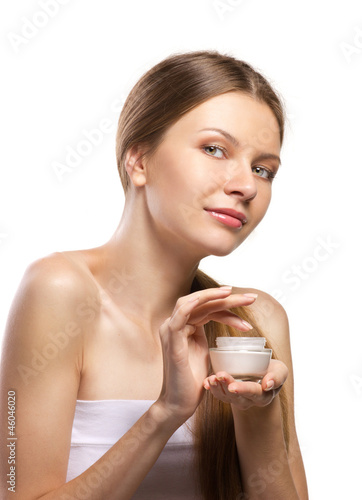 beautiful  women applying cosmetic cream