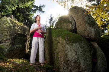 Relaxing Woman between Rocks