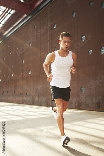young man running on the street