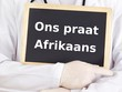 Doctor shows information: we speak afrikaans