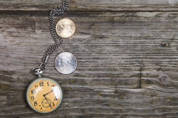 Old clock and coins