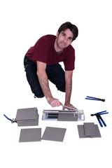 Man with a tile cutter