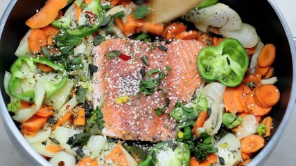 fresh salmon fillet with vegetables in the pan