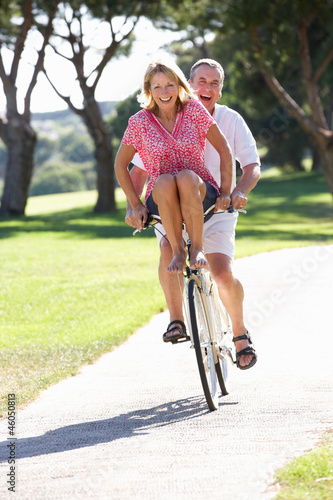 Senior Couple Enjoying Cycle Ride