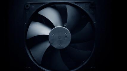 Fan turbine behind a dark surface