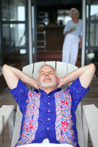 Senior man relaxing on a veranda