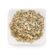 Ground dried Basil (Sweet Basil) in a white bowl on white backgr