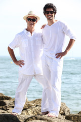 Father and son wearing white at the beach