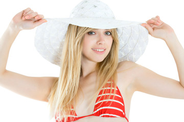 pretty cheerful woman wearing red swimsuit and straw hat