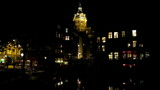 City scenic from Amsterdam in the Netherlands at night poster