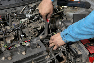 Car servicing, worker hands and tool, gasoline engine
