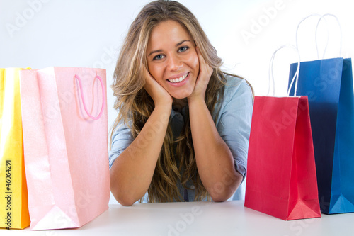 young woman with shopping bags on a white backgr