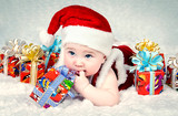 Cute little santa baby with New year's  gifts