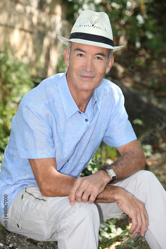 Senior man wearing a hat whilst in the garden