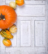 Pumpkins and gourds on an antique door panel