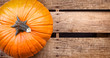 Pumpkin sitting on wooden crate