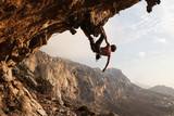 Fototapety Rock climber at sunset, Kalymnos Island, Greece