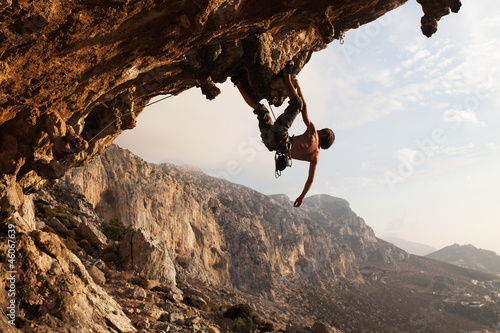 Staande foto Alpinisme Rock climber at sunset, Kalymnos Island, Greece