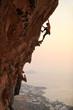 Leinwandbild Motiv Rock climber at sunset, Kalymnos Island, Greece