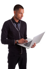 Young african american man using a laptop