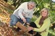 Two women gathering mushrooms