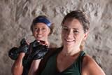 Smiling Ladies Holding Kettlebells