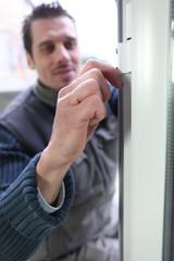 Man fitting double glazing