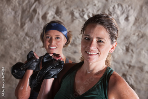 Smiling Ladies Holding Kettlebells