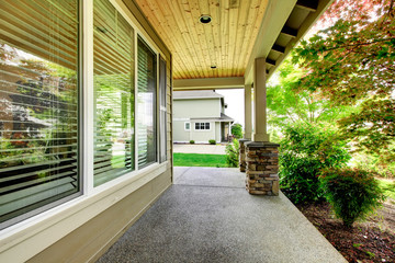 House covered porch with large window.