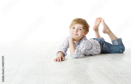 Child lying down on floor and looking at camera